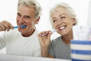 Img-blog-Senior Couple In Bathroom Brushing Teeth