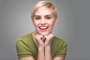 Pretty Woman Smiling With Hands On Chin