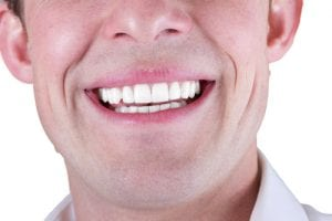 adult male smile closeup isolated on a white background-img-blog