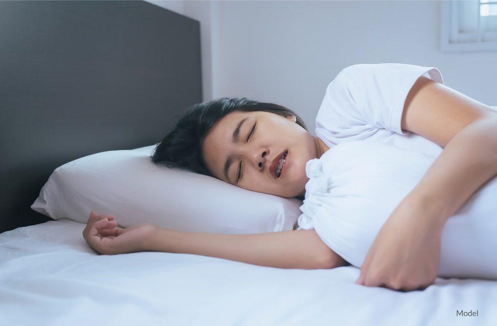 woman grinding teeth in her sleep